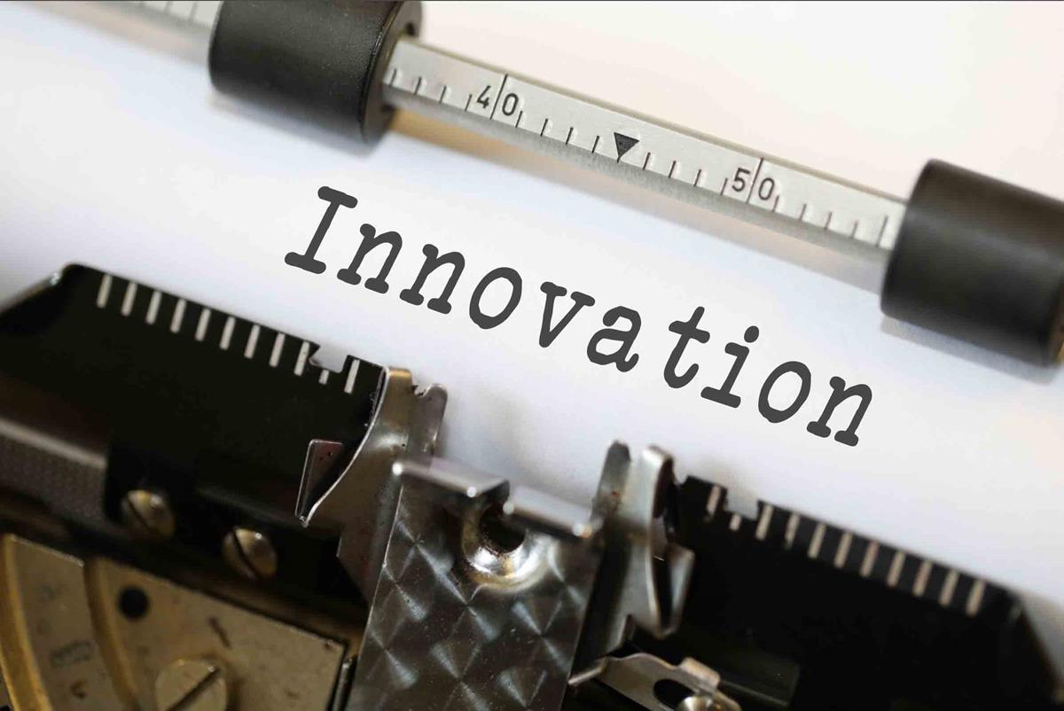 Image of a typewriter with 'Innovation' lettering on paper
