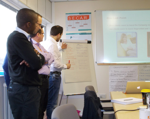 SECAR Training in front of the whiteboard